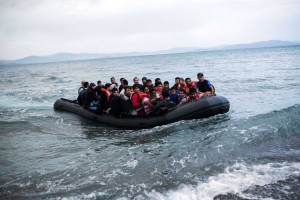 TOPSHOTS A dinghy overcrowded with Afghan immigrants arrived on a beach on the Greek island of Kos, after crossing a part of the Aegean Sea between Turkey and Greece, on May 27, 2015. AFP PHOTO / Angelos TzortzinisANGELOS TZORTZINIS/AFP/Getty Images